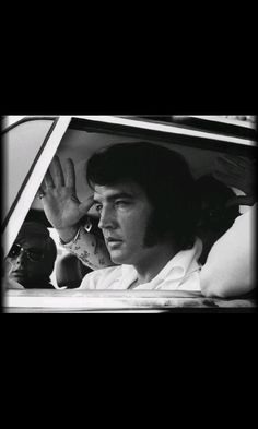 elvis presley 21 looks over a new lincoln continental mark ii in miami florid. Black Bedroom Furniture Sets. Home Design Ideas