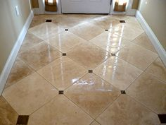 shiney foyer tile floor with dots but shiny is slick and someone will crack - Foyer Tile Design Ideas