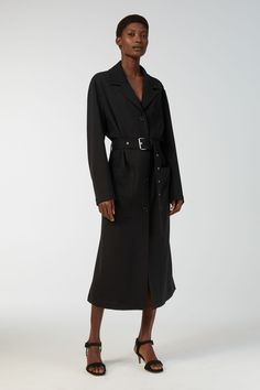 Versatile and relaxed, this unlined coat is made from a fluid wool fabric, produced by an Italian mill. Designed with a straight silhouette, the belted coa