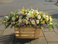 Double Ended Spray of pastel Spring flowers including Tulips, Stocks, Narcissi, Roses, Lisianthus and Mimosa. Florist London, Funeral Sprays, Funeral Tributes, Same Day Flower Delivery, Spring Flowers, Tulips, Roses, Pastel, Seasons