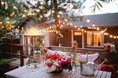 Beautiful backyard string lights and flower arrangement