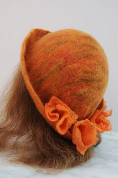 How to use a Resist Shape to Create a Wet Felted Hat and Flowers