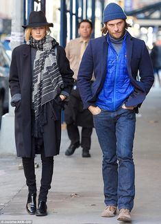 Keeping her company: The blonde beauty was joined by a male companion who appeared hip in a blue look