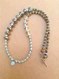 Asymmetrical jewelry Sterling silver and by NanabojoDesigns, $40.00