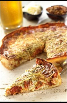 Pizza dough, tomato sauce and mozzarella are layered in a springform pan for deep-dish dinner.