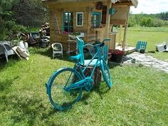 This is my sister's Lora's back yard & garden shed!  She painted the bike for her garden at the front.  Beautiful job Sista!