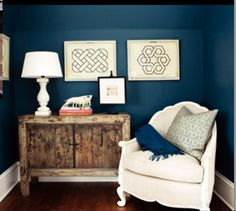 Benjamin Moore Newburg Green on the walls - love the bergere chair next to the rustic console, and those prints rock