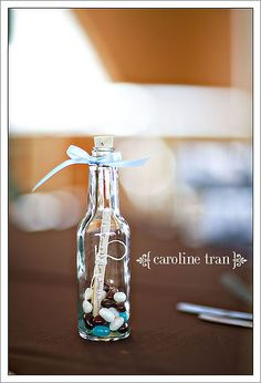 "table toppers. favors. include your own message. fill with beans and guests can use as ""Wedding bells"""
