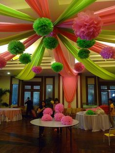 rolls of plastic table covering and paper poms out of tissue paper.  Big impact for little money.