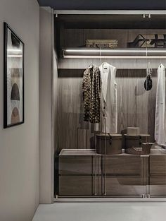 Shakedesign_Wardrobes_Freedom wardrobe with structure in T49 cenere, bronze glass doors without frame, light bronze details and handles in burnished brass. With drawers and coat-hangers