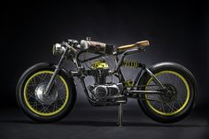 dubbed the one, austria's titan motorcycles customizes a honda CB350 into a crazy racer.