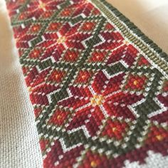 Cross stitch embroidery for Telemark beltestakk bunad. Made by Mona Øvregård in Bunadsystua Liv Laga.