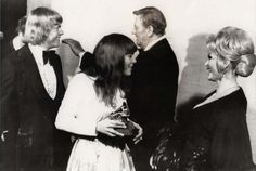 "It was John Wayne in 1968 who wanted Karen Carpenter to co-star with him in the 1969 film ""True Grit."" The legendary superstar was that taken with Karen, who was still unknown at the time. Unfortunately, Wayne could not convince producers to take a chance on the young superstar-to-be, and instead signed actress Kim Darby for the role. Rats! Seen here with Wayne and Carpenter is brother Richard Carpenter, and Zsa Zsa Gabor. WOW."