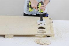 Cutting holes for a Four-in-a-Row outdoor game DIY project
