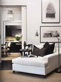 This looks like an amazing place to read a book!  Love this chaise lounge.  love the contrast of black and white.  So luxe