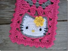 Close up of Hello Kitty crochet granny square with flower - follow link for free pattern from 'Made by K'