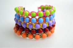 This is a DIY bangles tutorial. The contents include detailed illustrations and elaborate directions on how to make bangle bracelets out of common Nylon Thread and Colorful Acrylic Beads. During the whole project, you just need to tie the simple Square Knot to anchor your beads.