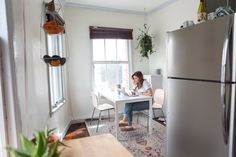 Lee loves the light in the kitchen and dining room and often finds herself working here as well. The dining room rug was bought at RugsUSA. The dining room table and chairs are IKEA.