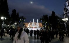 Greece: An illuminated boat—an old Greek symbol—decorates Athens' Syntagma Square in front of the Greek parliament on Dec. 13, 2013. (AP Photo/Petros Giannakouris)
