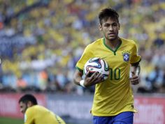 Brazil's Neymar holds the ball during the group A World Cup soccer match between Brazil and Croatia, the opening game of the tournament, in ...