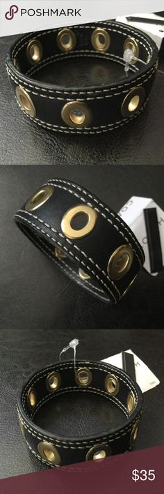 """Coach Leather Grommet Bangle Bracelet Authentic Coach.  NWT F94126.  Black leather, white contrast stitching, brass grommets, Coach heat stamp.  Measures about 7.5"""" inside and 1"""" in height.  No trades. Coach Jewelry Bracelets"""