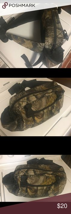 MAN BAG ALERT!! Camo alert! FANNY BAG ALERT! Huge This sucker is massive compared to our little fanny packs! I could fit all three of my kids in this one! They get all the good stuff! Jk this one is camo with 1 large and 1 small zipper pocket. Good condition. Realtree Bags Luggage & Travel Bags