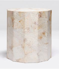 Featuring the natural color variation of Kabibe shell, the Enzo Stool from Made Goods creates this beautiful luxe design with a heat molding process of the shell, making each piece unique. This faceted home accessory could also be used as a side table anywhere in your home or office.