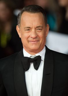 Pin for Later: 45 Famous, Sexy Silver Foxes Tom Hanks