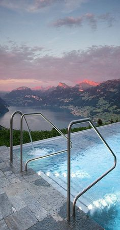 Hotel Villa in Honegg in Switzerland. Rising high on Mount Bürgenstock, this early 1900s villa offers luxurious rooms with balconies and a heated infinity pool overlooking Lake Lucerne.