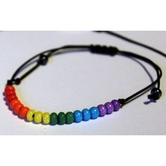 Rainbow Gay Pride Bracelet Lesbian Jewelry LGBTQ ($14) ❤ liked on Polyvore featuring jewelry, bracelets, rainbow bracelet, rainbow jewelry, bracelet bangle and bracelet jewelry
