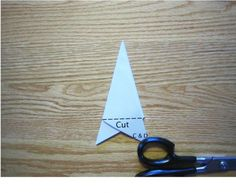 How to fold the starting triangle for successful snowflakes! Make sure to use thin paper, verses thick.