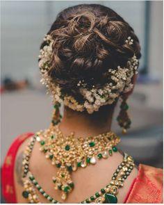 A pretty bun with curls and flowers on the underside | The ultimate guide for the Indian Bride to plan her dream wedding. Witty Vows shares things no one tells brides, covers real weddings, ideas, inspirations, design trends and the right vendors, candid photographers etc.| #bridsmaids #inspiration #IndianWedding | Curated by #WittyVows - Things no one tells Brides | www.wittyvows.com