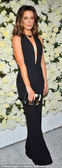 Beauties in black! Kate Beckinsale and Gwyneth Paltrow wowed at the David and Victoria Bec...