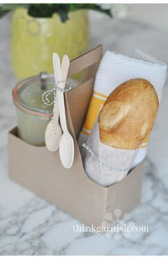 get well soon gift - garlish tote and wooden spoons: add jar of homemade chicken soup and some yummy fresh bread.  Maybe a chocolate truffle or two????