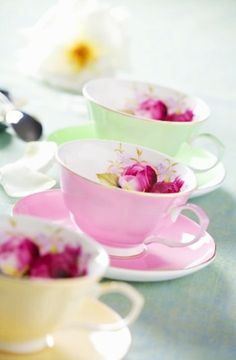 Pastel teacups with magenta flowers