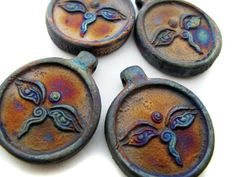 Size = approx. 1.25 inches tall  Holes drilled horizontal as bail at the top of the bead  Quantity = 4 beads    Made in Peru, each raku bead will
