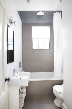 Google Image Result for http://www.pampai.com/wp-content/uploads/2012/08/Small-Bathroom-with-platinum-interceramic-floor-tile-wraps-into-tub-surround-and-modern-sink-above-open-vanity-also-shower-curtain-hung-from-track-on-ceiling.jpg