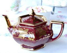 Vibrant burgundy and gold vintage teapot from Arthur Wood pottery dating from the 1940s