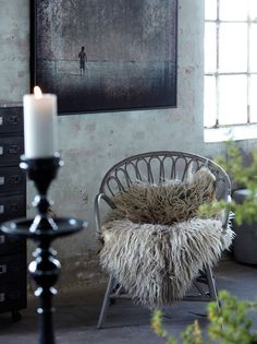 Wonderful use of textures to soften an industrial environment.   I live in an industrial style converted warehouse and lovely vintage metal filing cabinets and concrete floors get hard and exhausting to live in if not relieved by texture and softness.