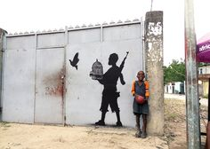 Peace unleashed by Goin in Kinshasa, Congo to comment on the issue of child soldiers in North Kivu. 2014. Photograph: Goin.  (via  Art Africa )