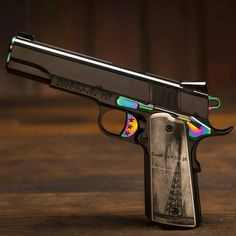 This custom Cabot Black Gold 1911 captures a deep black near-colorless infinity with its Physical Vapor Deposition, Diamond-Like Coating at the molecular level an extremely durable, yet elegant finish 1911 Pistol, Colt 1911, Kimber 1911, 1911 Grips, Weapons Guns, Guns And Ammo, Best Handguns, Weapon Of Mass Destruction, Submachine Gun