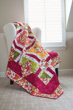 The fabrics in this quilt are a vacation for the senses. Choose a favorite large-scale floral and coordinating prints, and dream about the sunshine.