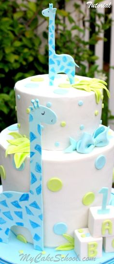 Learn this Sweet Giraffe Cake Design & the basics of creating a Double Barrel Cake! Cake Decorating Member Video by MyCakeSchool.com
