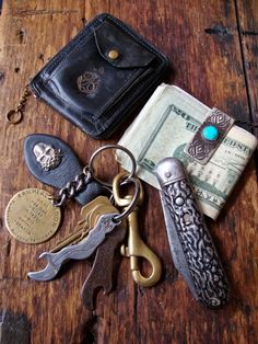 classic pocket knife, money clip and unusual black leather wallet