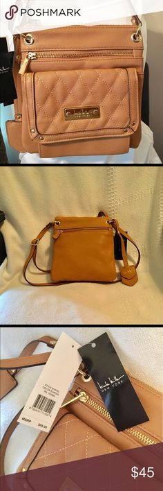 """New Nicole Miller New York Tan Purse. New Nicole Miller New York Tan Purse. This nice purse has Lots of room for a small purse. 3 Pockets on the outside. Adjustable strap. Measurements 8 1/2"""" x 7 1/2"""" Nicole Miller Bags Shoulder Bags"""