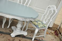 basically what i'm thinking for my place....Shabby chic table and chairs