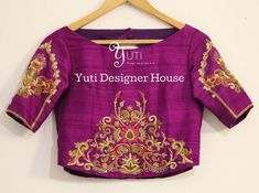 Zardosi embroidered blouse by YUTI! Beautiful wine color designer blouse with lotus flower and lata design hand embroidery gold thread and zardosi work. For Price and Other details reach us at or Whatsapp: 31 May 2018 Hand Work Blouse Design, Kids Blouse Designs, Saree Blouse Neck Designs, Bridal Blouse Designs, Blouse Models, Embroidered Blouse, Lotus Flower, Hand Embroidery, Zardosi Embroidery