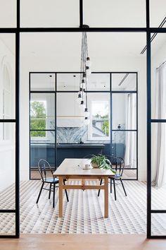 A sleek minimalist industrial dining space