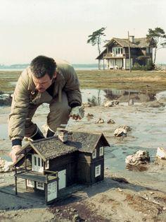 Director Andrei Tarkovsky preps a model house for a scene in 'The Sacrifice'. Cinema Video, Cinema Cinema, Tiny World, Miniature Houses, Fairy Houses, Little Houses, Mini Houses, Model Homes, On Set