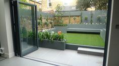 modern small low maintenance garden fake grass grey raised beds contemporary planting docklands tower bridge london